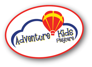 Adventure Kids Playcare logo. A tilted white oval with the name inside. Over the name is a blue line representing the top of a cloud, with a red and yellow hot air balloon between the first two words.