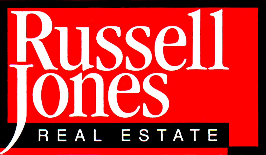 Russell Jones Real Estate logo. A red rectangle with a black border. Inside, the words